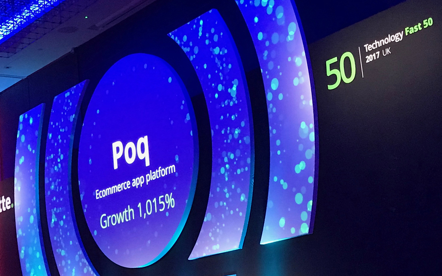 Poq on screen at Deloitte Fast50 Awards
